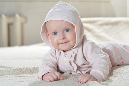 look after: Bathroom textile for babies and children beautiful happy baby after bath look at the camera