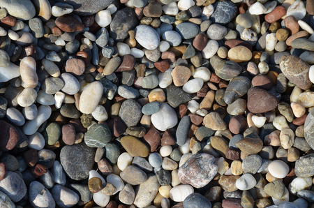 background made of a closeup of a pile of pebbles gravel stone