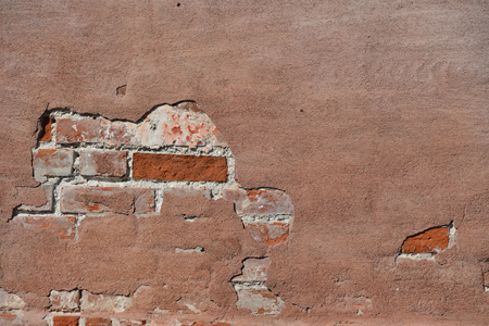 Old red brick wall damaged background texture real photo.  Grunge Red Stonewall Background 스톡 콘텐츠