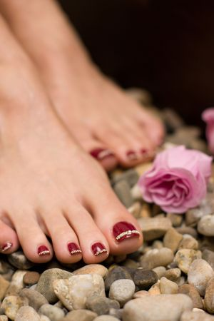 Red pedicure for woman cosmetic photo