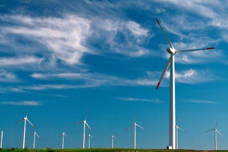 Wind Power Generator on blue sky photo
