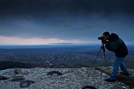 Photographer on the high rocks