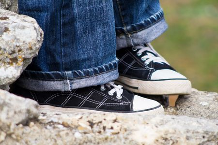 Blue jeans with dark sneakers photo