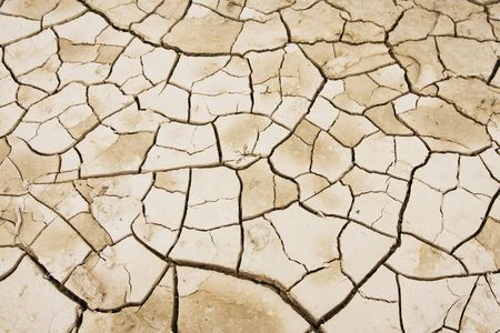 parched: Cracked mud texture Stock Photo