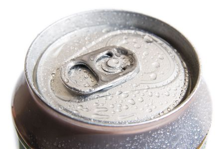Close-up of metallic beer or soda can on white background. Metal can shoot from top. photo