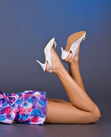 Young woman with shoes and fashion home clothes . photo