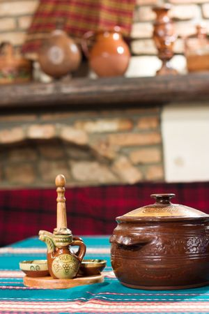Old village tavern. Rural interior of table with cup of meal and blur background.