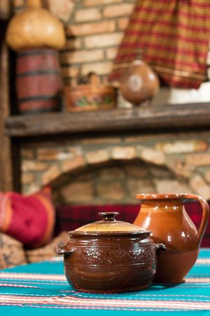 Old village tavern. Rural interior of table with cup of meal and blur background. photo