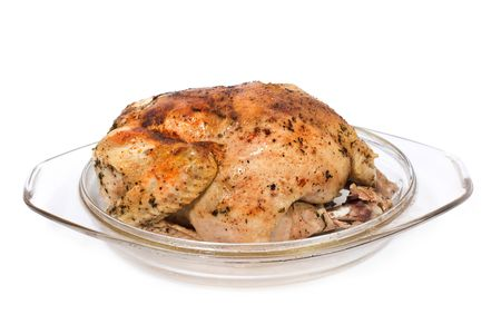 Roast chicken in glass plate isolated on white photo