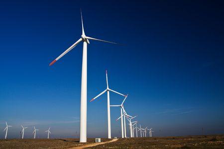 Wind power generators on blue sky photo