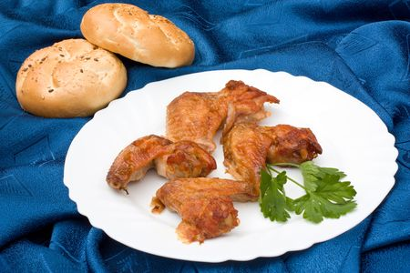 Chicken wings arranged with loafs of bread Stock Photo - 6340104