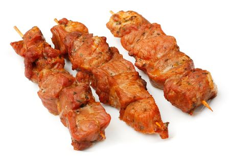 Chicken skewers isolated over white plate.