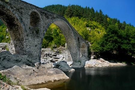 Old stone bridge in Rodopi mountain. Diavolskia most. photo