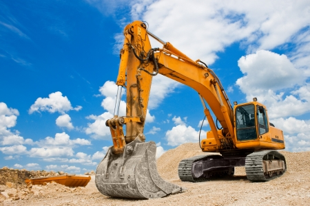 Yellow Excavator at Construction Site photo