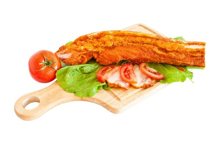Pork fillet on wood, arranged and isolated on white photo