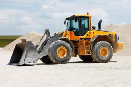 Yellow Excavator at Construction Site photo