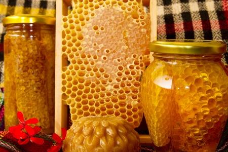 Jars of honey and honeycomb Stock Photo