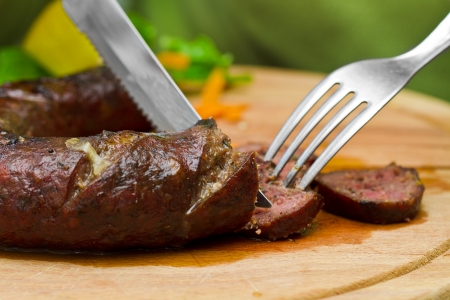 Hot fresh sausage on wood plate