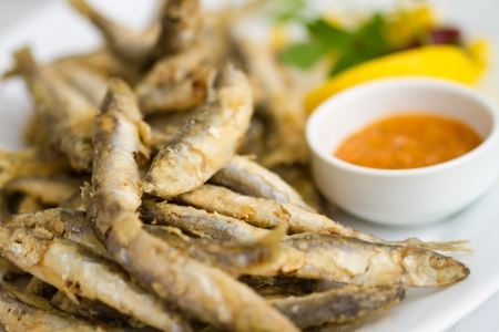 sprat: Fried fresh sprat fish with souce  Good seafood  Stock Photo