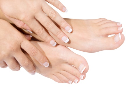 french pedicure: French manicure and pedicure isolated over white