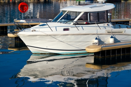 afloat: White yacht on dock in sea Stock Photo