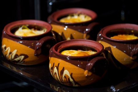 clay pot: Stew pot with sausage and cheese