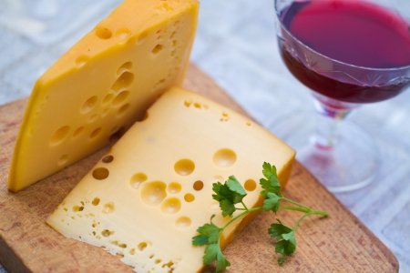 Emental cheese and wine shoot with short DOF Stock Photo