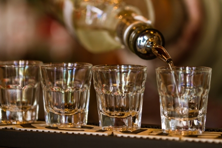 tequila: Barman make alcoholic shots in nightclub