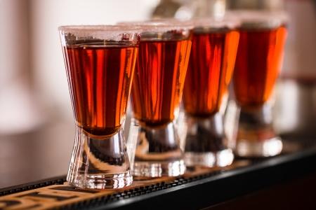 Barman make alcoholic shots in nightclub photo