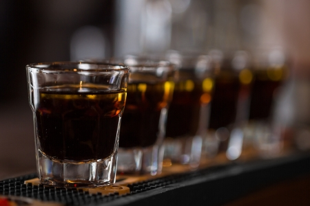 Whisky shot drinks in row  Alcoholic shots in nightclub