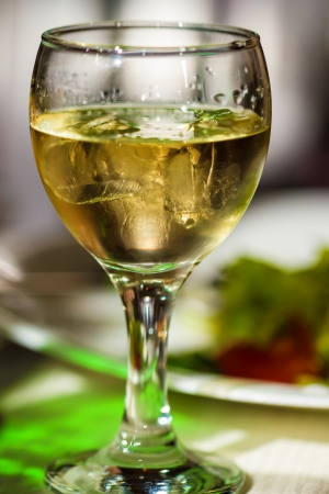 Glass of white wine or vermouth and ice  Picture proper for menu design