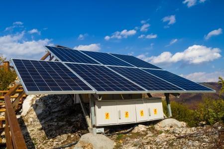 electricity generator: Solar panels instalation with blue sky Stock Photo