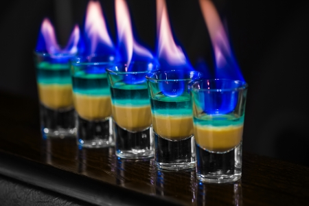 Barman make alcoholic shots with absent in nightclub 版權商用圖片