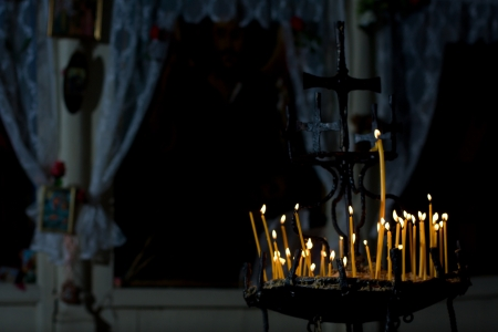 Candles burning in christian church photo