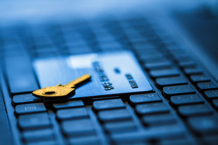 credit card and key on keyboard