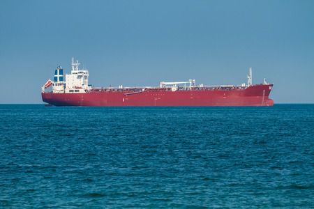 sailing boats: Big cargo container ship in sea waiting harbor freight