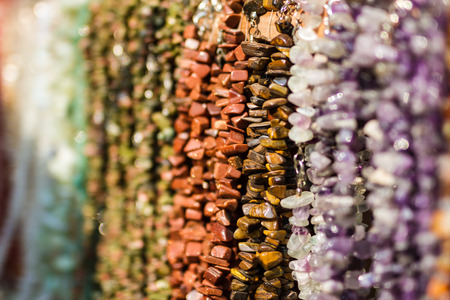 semiprecious: Background from multicolored semiprecious polished stones on jewellery market