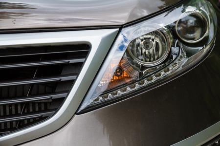 xenon: Closeup headlights of car. Fast car detail.