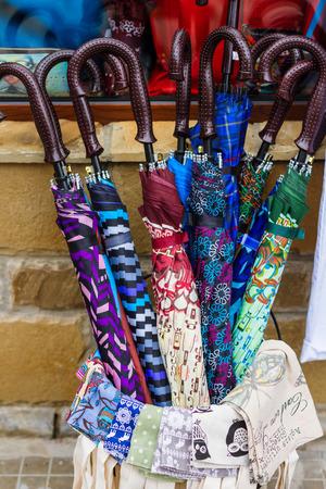 umbrela: Multi colored umbrella on sale on market place. Stock Photo