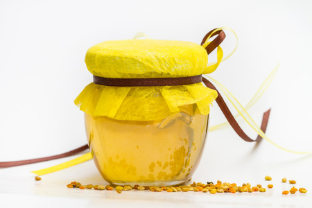 studious: Herbal honey in jar with small honeycomb and herbs isolated on white background Stock Photo