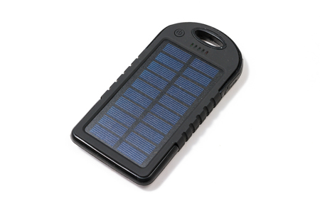 Portable solar charger for smart phone. Power bank isolated on white. Stock Photo