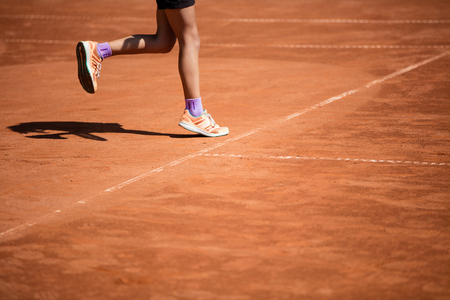clays: Tennis balls in the shade nets on the ground of clay court