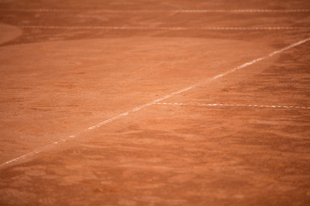 tennis clay: Tennis balls in the shade nets on the ground of clay court