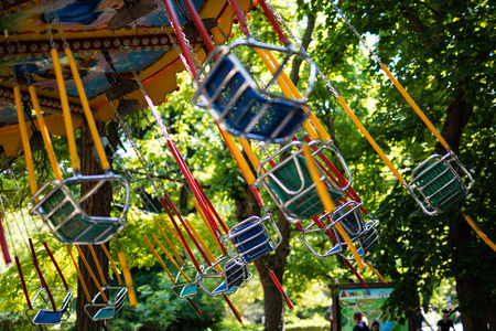 chain swing ride: Swing seat carousel exciting ride at amusement park Stock Photo