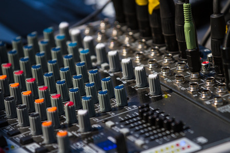 adjuster: Close up of a old studio mixing table. Audio sound mixer control panel.