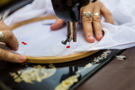 Textile embroidery machine. Machine embroidery is used to create patterns on textiles.