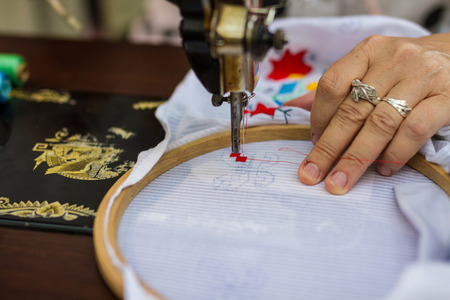 fashion art: Textile  embroidery machine. Machine embroidery is used to create patterns on textiles.
