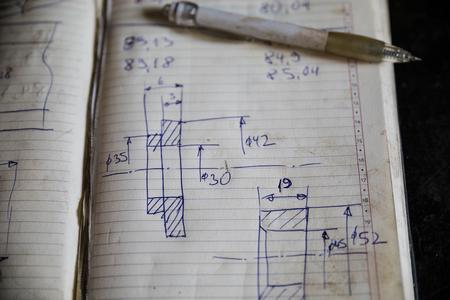 machine part: Hand drawn sketch of machine part on white paper Stock Photo