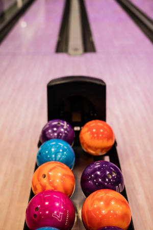 alley: Bowling balls and wooden lane in bowling hall Stock Photo