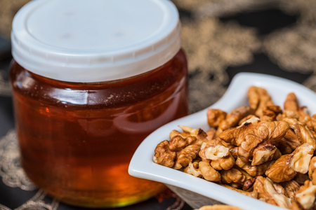 Sweet honey and walnuts for breakfast. Sweet nuts .